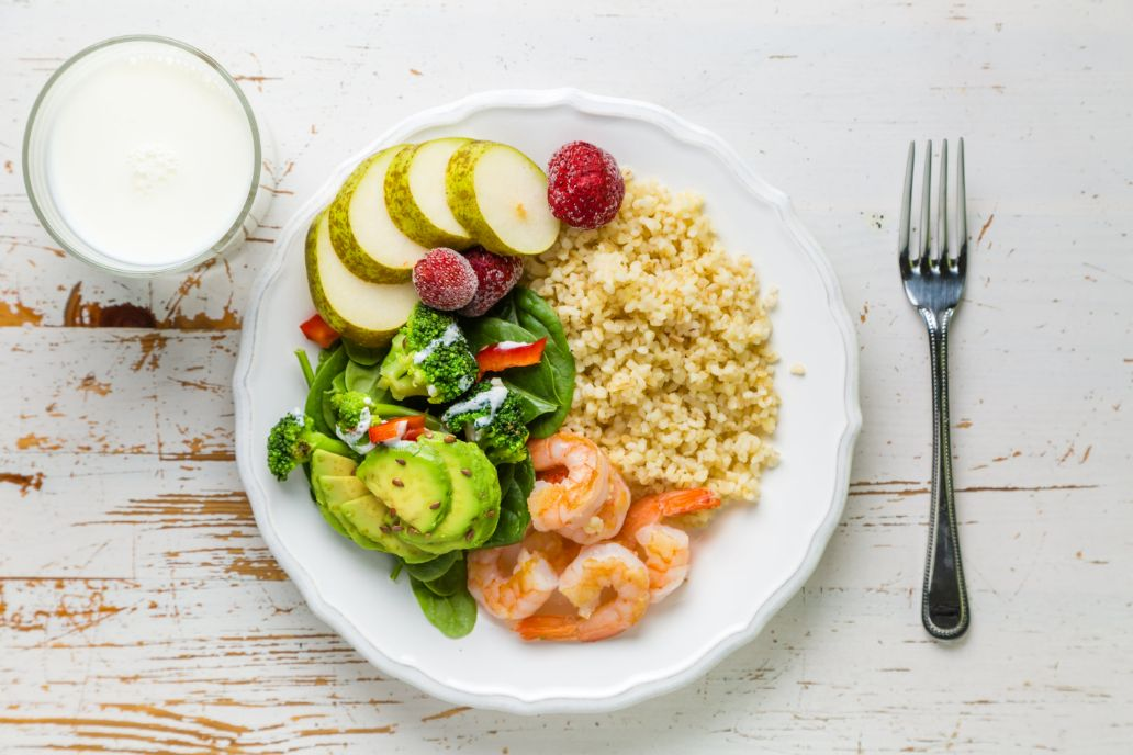 A healthy plate is 1/2 vegetables and fruits, 1/4 protein, and 1/2 grains | Shutterstock